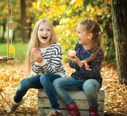 85398092 - smiling girls in the autumn park